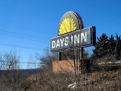 The Days Inn sign facing the road is unchanged.