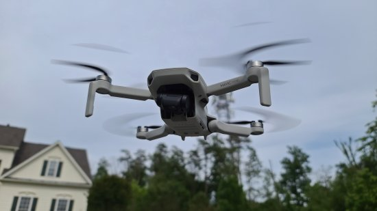 DJI Mavic Mini in flight. Note that the camera is cocked to one side.