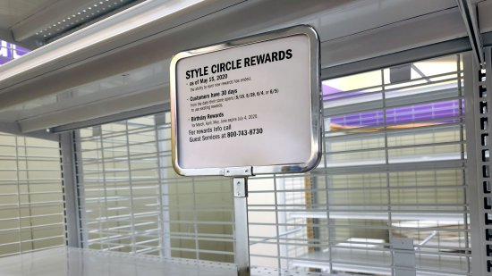 Signage explaining what would happen with Stage's rewards program and store credit cards.