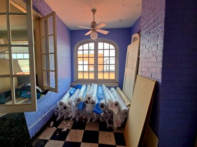 Side room off of the living room, with a window to the kitchen. I suspect that this used to be a dining room.