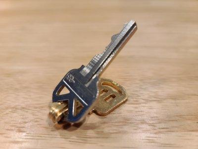 The unauthorized key bent around the authorized key