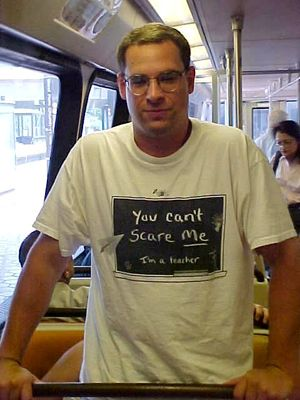 """I got a photo of this guy on the train because I liked his shirt: """"You can't scare me. I'm a teacher."""" I got the photo to show to Mom, who, at the time, worked as a middle school teacher."""
