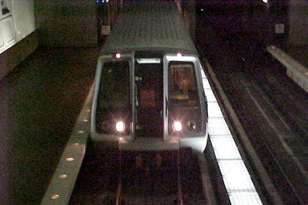 An Orange Line train to Vienna arrives at Virginia Square station.
