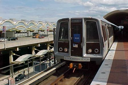 A Blue Line train to Addison Road arrives at National Airport station. Note the 1000-Series (Rohr) car in the lead position.