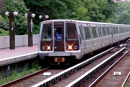 A Blue Line train arrives at Arlington Cemetery station on its way to Franconia-Springfield.