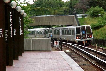 A Blue Line train departs Arlington Cemetery station on its way to Franconia-Springfield.