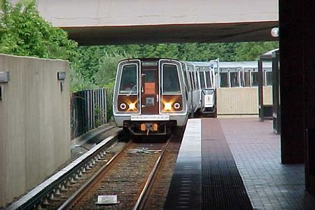 A Vienna-bound Orange Line train arrives at West Falls Church station.