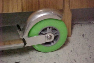 The rear wheel of the scooter, showing the brake