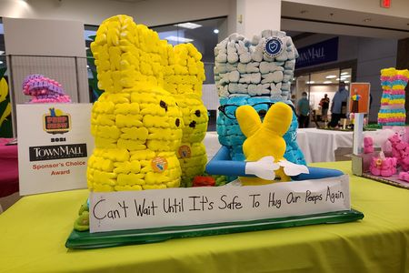 """One of many cringeworthy pandemic-themed Peeps displays, this one captioned, """"Can't wait until it's safe to hug our Peeps again."""""""