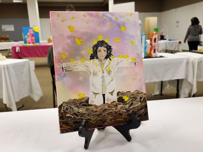 Painting showing what we believe is Tommy Wiseau coming out of a nest surrounded by Peeps.