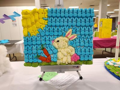 Picture of a rabbit carrying carrots made out of Peeps.