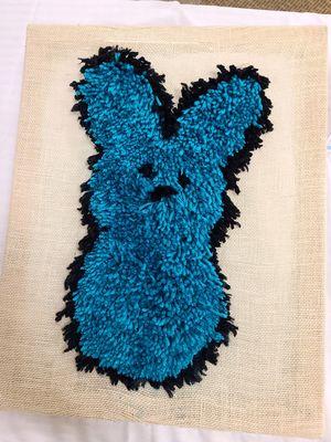 Yarn Peep sewn into a piece of fabric.