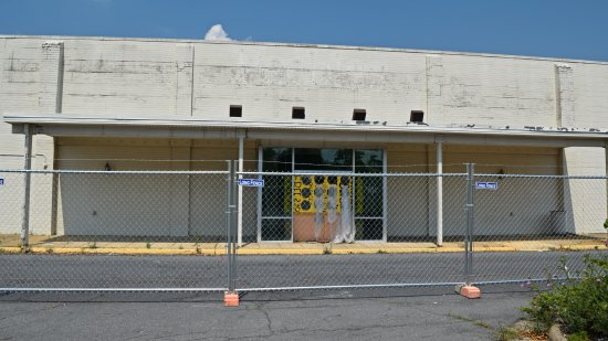 Exterior entrance to the former Peebles store. Like the JCPenney building, asbestos abatement was underway at time that these photos were taken.