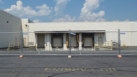 Fencing in front of the loading dock for the former Montgomery Ward building.