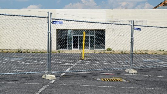 Fencing in front of the entrance to the former Montgomery Ward building.