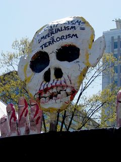 This particular street puppet, with a likeness of George W. Bush on one side, and a skull on the other, makes another appearance at a demonstration, having made a previous appearance at J20.