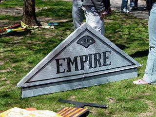 "A triangular cardboard cutout simply reads ""Empire""."