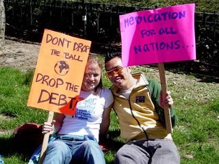 """These two participants held up signs saying """"Don't drop the ball, drop the debt!"""" and """"Medication for all nations..."""""""