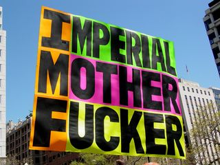 The gentleman who, for J20, carried a giant sign dropping F-bombs on George W. Bush, changed his sign accordingly, now referring to the World Bank and the IMF.