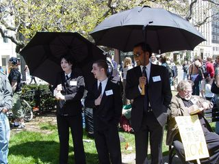 People from the Boston Direct Action Project dressed up as vampires, with black suits, white faces, vampire fangs, and large black umbrellas, pretending to be World Bank PR representatives.