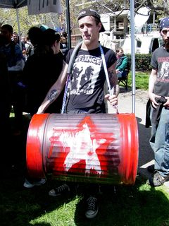 This gentleman decorated a trash can, and was using it as a giant drum.