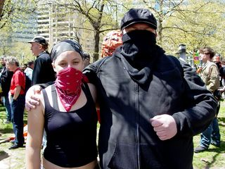 """Sis agreed to take a photo of Jess and I with Big Mavica. As you can see, the Black Bloc look is """"in"""" at these events."""