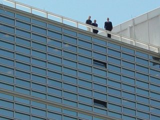 The group of people on the roof of the World Bank, watching the demonstration from above.