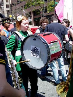The Rude Mechanical Orchestra played music the entire way, dressed in green band uniforms.