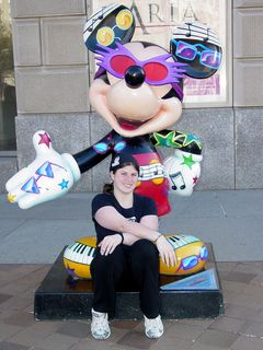 Sis poses with the Elton John-themed Mickey outside the Reagan Building.