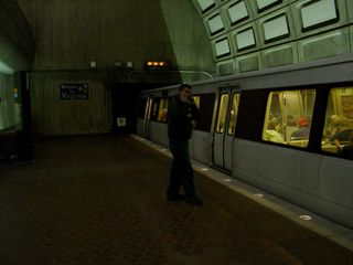 An eight-car train at Rosslyn. You can tell it's eight cars by the fact that it's pulled all the way up to the tunnel portal. Normally, four-car and six-car trains center themselves on the platform, leaving space at both ends. Eight-car trains fill the entire length of the platform.