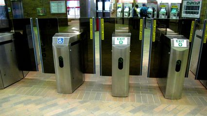MBTA faregates. When opening after processing your CharlieCard or CharlieTicket, the gates move up and to the side to allow passage.