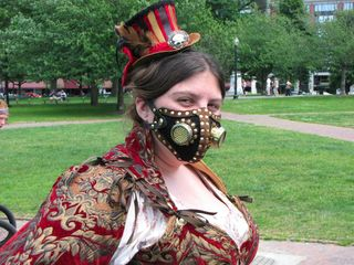 HT smiles (we'll take her word for it on that) for the camera in her steampunk hat and mask.