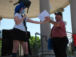 The presentation of the wig to Larry Brennan, complete with certificate of authenticity.