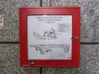 The fire alarm annunciator, showing the source of the alarm over a map of the station.