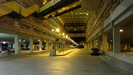 The bus loop, where the hotel shuttle picked up and dropped off its passengers, under the giant parking garage at Quincy Adams.