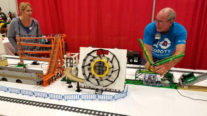 I saw a lot of animated displays at BrickFair. This one, called Mindstorms Machines, took a ball through a course and then eventually loaded it onto a train, which brought it back to the start. It reminded me of the Swiss Jolly Ball at the Museum of Science and Industry in Chicago.