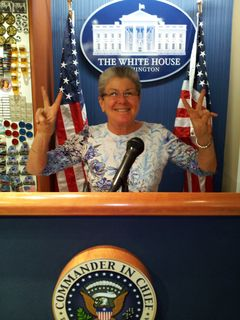 At the America! store at Union Station, they had a lectern set up like the White House press briefing room. And each of us decided to ham it up a little. I posed like I was giving an impassioned speech, and Mom did a Nixon-esque pose.