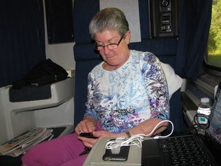 Mom checks her cell phone from the train. Between that and her iPod, that was her computer for this trip.