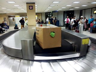 The first piece of luggage arrives in the baggage claim room in Chicago from the Capitol Limited!