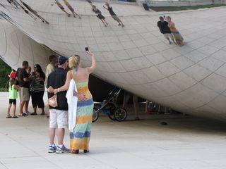 After doing the Mag Mile, we went to meet Sis. After that, we headed over to Millennium Park, which is a favorite place for me to photograph. I first got some photos of people looking at and photographing themselves on the bean...