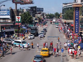 """The next day, on the way to the Museum of Science and Industry, we noticed the crowds outside Wrigley Field from the """"L"""" at Addison station ahead of a Cubs game. I admit - I've never been to Nationals Park, so this was a bit of a novelty for me to see."""