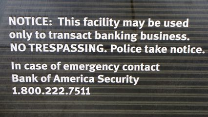 """This sign struck me as rather heavy handed. This is on a Bank of America branch in the Loop area downtown. Specifically, the """"NO TRESPASSING. Police take notice."""" part was what struck me as excessive. Really, Bank of America? Isn't this a bit much?"""