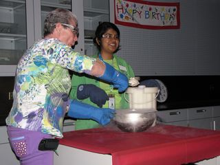At the end of the liquid nitrogen demonstration, they made ice cream. I got Mom to volunteer to help with the demonstration. Here's Mom stirring the ice cream mix while the person running the show adds the liquid nitrogen, and then the remains of the ice cream after everyone had a cup of it.