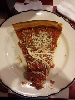Back in Rogers Park, we went to Giordano's for some authentic Chicago-style deep dish pizza. It was awesome. If you've never tried it, you must do so the next time you're in Chicago. The top photo is one of my slices, and the bottom photo is the second half of the pizza after we each got a slice.
