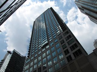 This is Sis's building. Very impressive, if you ask me. It's a mixed use building with offices on the lower floors and condos above. Considering the location of this building, I don't even want to know how much these condos cost, but I guarantee you that I wouldn't be able to afford it.