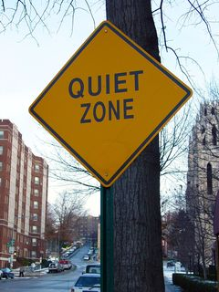 """On the way to Malcolm X Park, I encountered this sign, indicating that this was a """"Quiet Zone"""". I am not quite sure what to make of this sign, since I'm not entirely sure what it's referring to."""