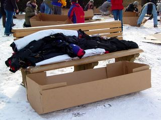 The cardboard coffins were being assembled by volunteers on the side of the rally site. Some of the coffins were covered with black cloth, and others were covered by American flags.