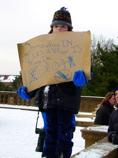 """I thought it was great to see people getting involved in politics so early on in life. And even better, these people appear to have created these signs themselves, saying, """"Send our troops home NOW!"""" and """"Somewhere in Texas a village is missing its idiot!"""""""