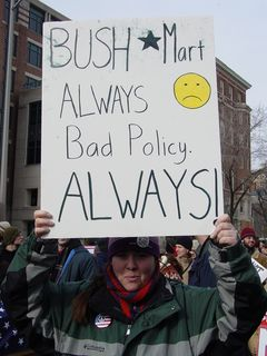 I ended up spending the rest of the march with this woman and her friend, as the march continued. She carried her Bush-Mart sign, and I marched alongside.