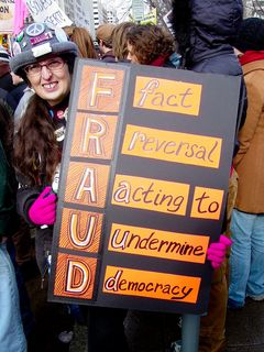 """This poster turns """"Fraud"""" into an acronym: Fact Reversal Acting to Undermine Democracy."""